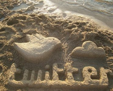 How to Run a Twitter Hour Twitter logo in sand